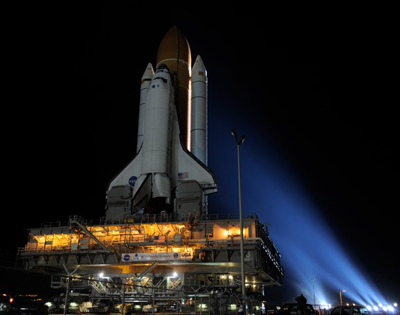 Space shuttle Discovery during its crawl to the la