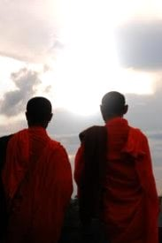 Two Buddhist monks face the sky