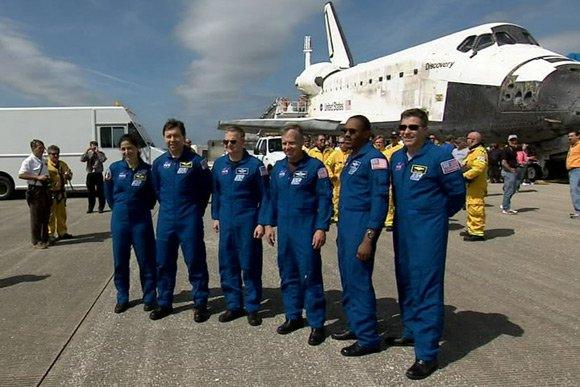 The Discovery crew poses at Kennedy yesterday. Pic: NASA