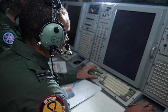 A crewman aboard an RAF E-3D AWACS plane monitors the air picture over Libya. Credit: Crown Copyright/SAC Andy Stevens