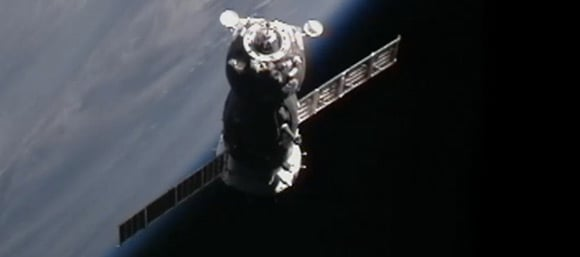 The Soyuz TMA-21 just before docking with the International S