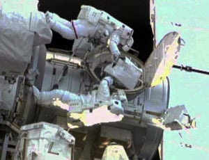 Drew Feustel (top) and Mike Fincke conduct the second spacewalk of the STS-134 mission. Photo: NASA TV