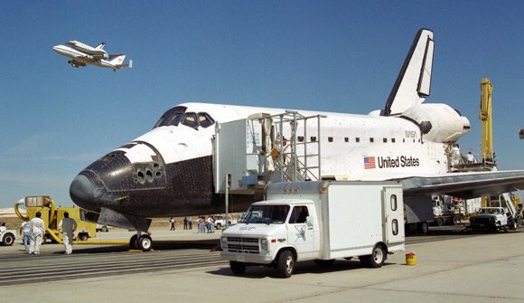 Shuttle Columbia, atop the Shuttle Carrier Aircraft, flys past Endeavour at Kennedy Space Center in 1994. Pic: NASA