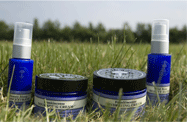 Neal's Yard jars and spray in field