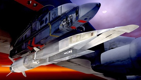 An X-51A scramjet attached to the wing of a B-52 bomber read