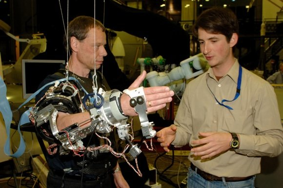 ESA astronaut Christer Fuglesang works with Exoskeleton in the robotics lab at ESTEC. Credit: ESA/J van Haarlem