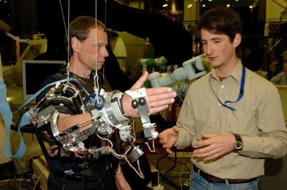 ESA astronaut Christer Fuglesang works with Exoske