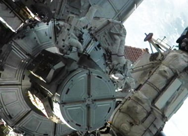 Mike Fossum and Ron Garan exiting the Quest airlock at the beginning of today's EVA. pic: NASA TV