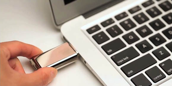 Crave's Duet USB flash drive and vibrator recharging in a MacBook Air