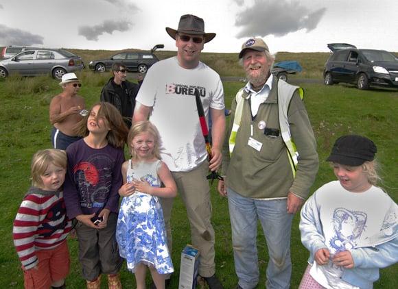 John Bonsor with Bill Ray and family, and the NAOMI rocket
