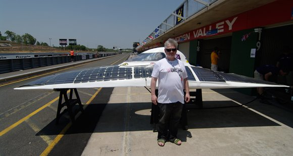 Drew Cullen poses with a solar car