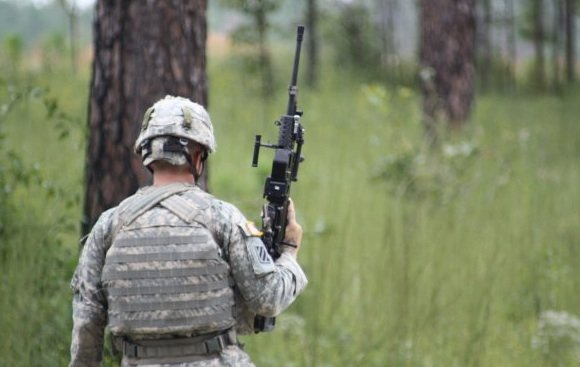 Specialist Brandon Smith carries the LSAT LMG one-handed. Credit: US Army