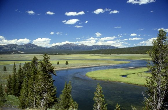 The rim of a supervolcano caldera seen in the distance in the Yellowstone National Park. Credit: US National Park Service