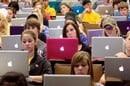 Students using MacBooks in a lecture hall