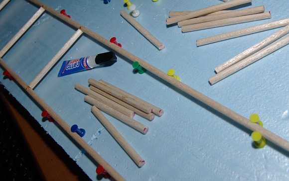 Balsa wood dowels coming together in our assembly jig