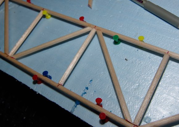Diagonal dowels in place on one face of the truss
