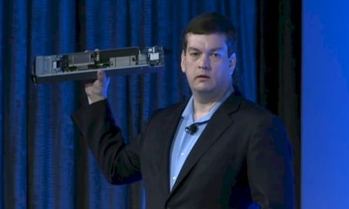 Dell's Forrest Norrod holding a baby blade server
