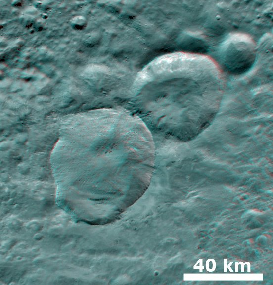 3-D anaglyph shows the Snowman craters on asteroid Vesta. Credit: NASA/JPL-Caltech/UCLA/MPS/DLR/IDA