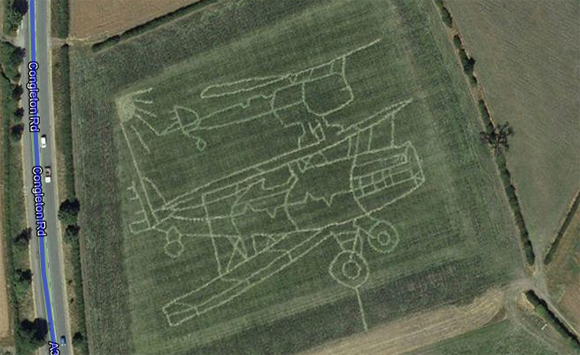 The outlines of two vintage aircraft seen in Staffordshire field