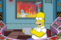 Homer Simpson reading on a tablet
