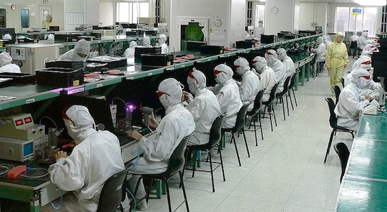 Workers in a Foxconn plant, credit