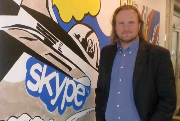 Tiit Paananen, boss of Skype Development labs, in front of Skype mural in the Estonia head office