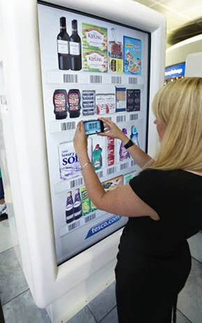 Woman uses Tesco virtual shop