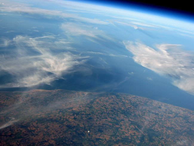 The view from Dave Akerman's payload at 34.8km, showing Mark's balloon expanded to an estimated diameter of 10 metres