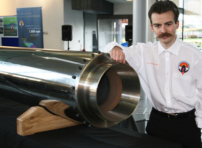 Daniel Jubb poses with his hybrid motor. Pic: Bloodhound SSC