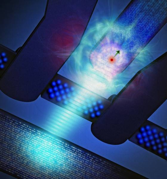 "Artist's impression of a phosphorus atom (red sphere surrounded by electron ""cloud"", with arrow showing the spin direction) coupled to a silicon single-electron transistor. A burst of microwave radiation (light blue) is used to 'write' information on the electron spin. Credit: Tony Melov"