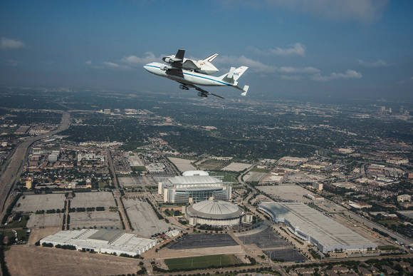 Space shuttle Endeavour over Reliant Stadium and Astrodome