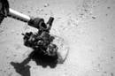 Curiosity's robotic arm probes first rock