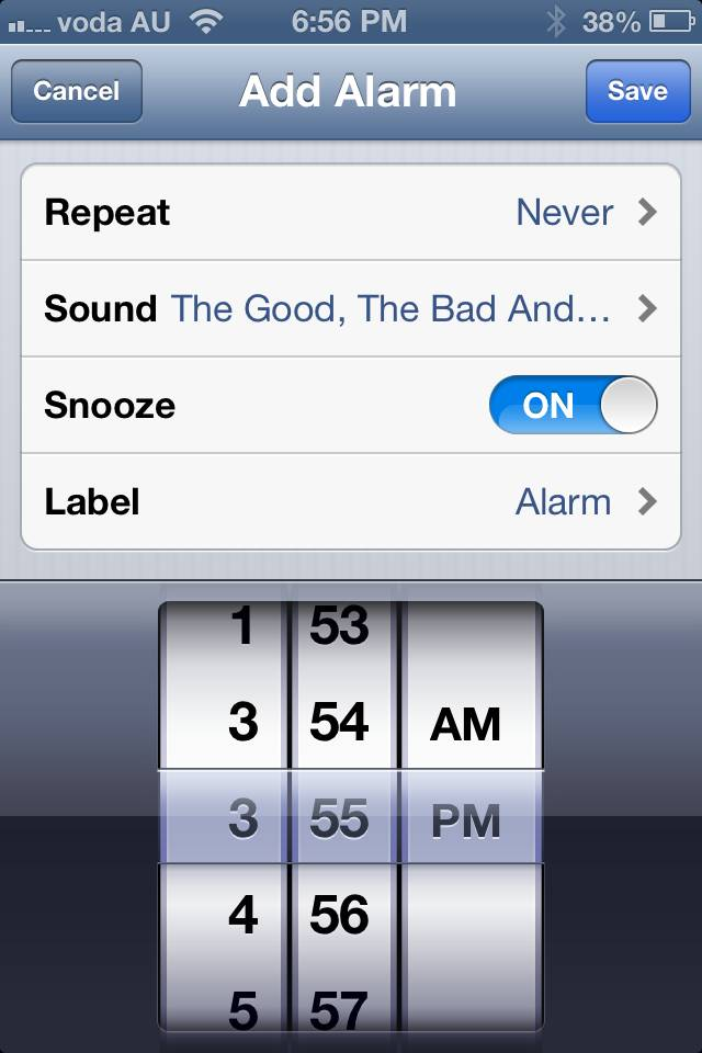 An iPhone 4 running iOS6 and displaying the bug in the Alarms function of the Clock app