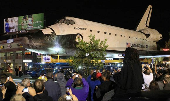 The Space Shuttle Endeavour being trucked through the streets of Los Angeles