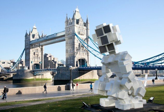 The Public Toilet installation at Tower Bridge, London ­ a giant sculpture of a squatting man ­ com