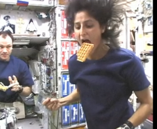 Sunita Williams eating a waffle, credit screengrab NASA video