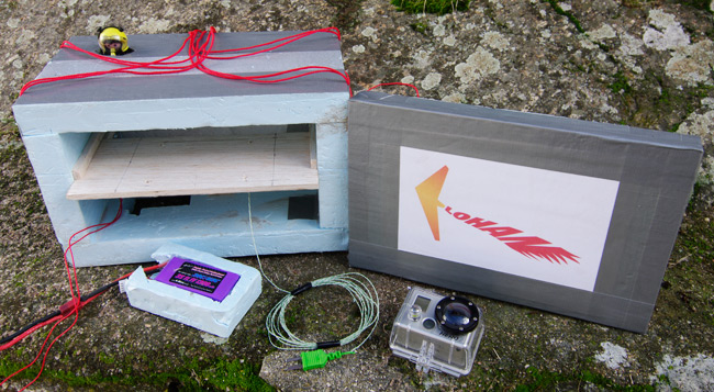The payload box for the flight, with vid camera and heater battery shown