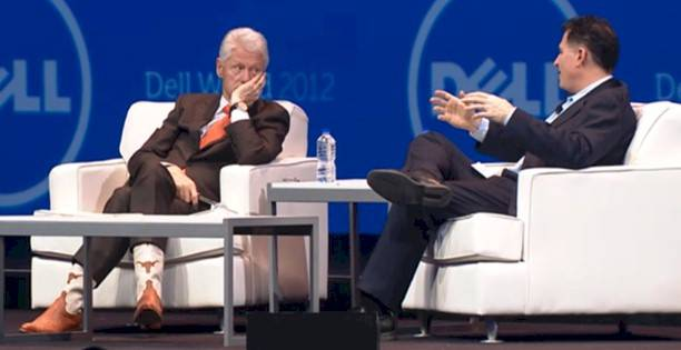 President Bill Clinton showing off his boots and his brains at Dell World
