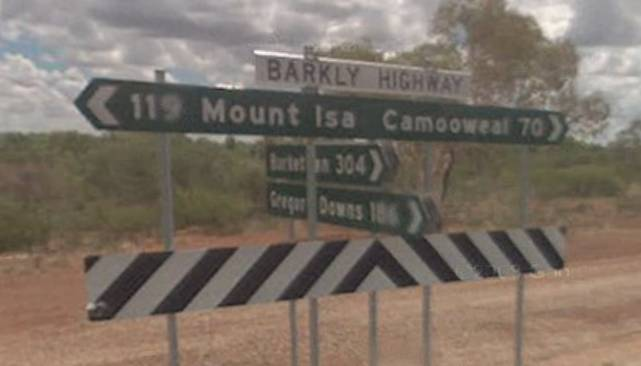 Signs on the Barkly Highway showing the way to Mount Isa