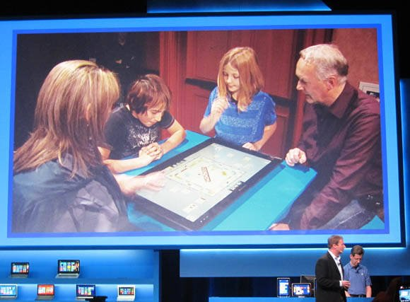 Intel envisions a family playing digital Monopoly on a 27-inch all-in-on PC lying flat on its back on the kitchen table