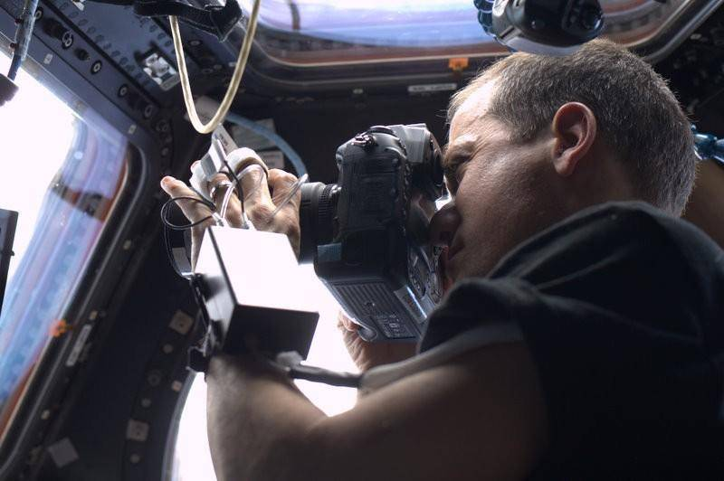 Astronaut Chris Hadfield taking photos on the ISS