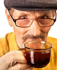 Old man drinking cup of tea