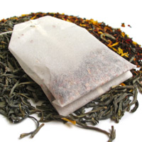 A teabag and loose tea