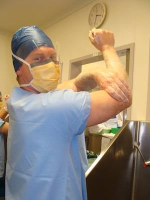 Richard Youd scrubs before his surgical training. Photo Copyright Pip
