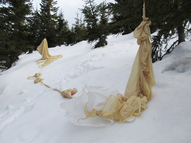 The remains of the balloon in the snow