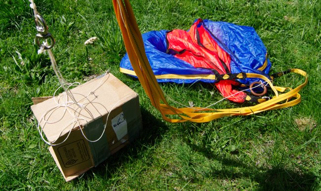 The parachute, cardboard payload box, rigging and igniter lines