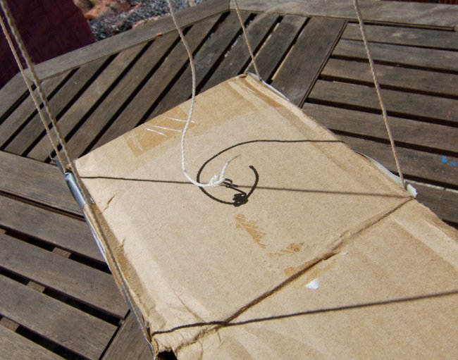 The igniter line attached to a length of steel wire poked into the top of the box