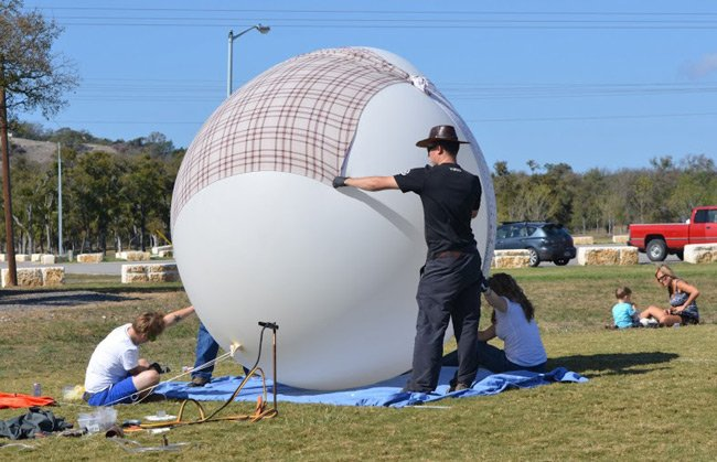 The massive balloon held under a couple of sheets