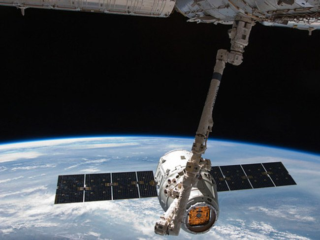 The Dragon spacecraft docks with the ISS. Pic: NASA