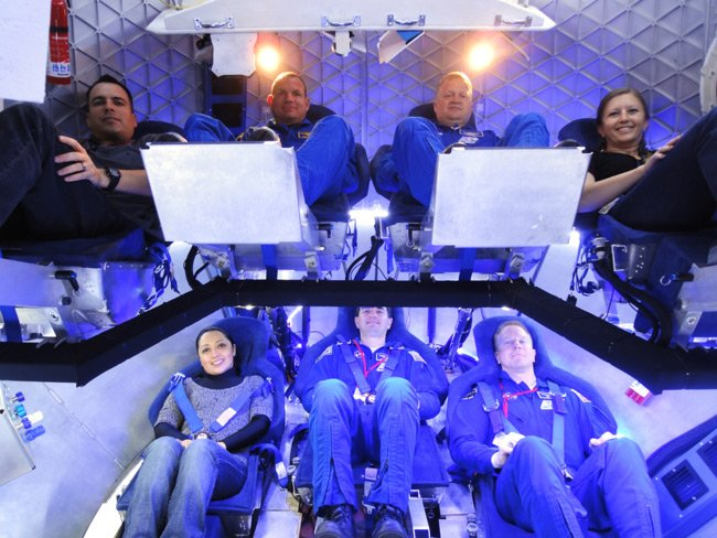 Inside the Dragon capsule (from top left): NASA Crew Survival Engineering Team Lead Dustin Gohmert, NASA Astronaut Tony Antonelli, NASA Astronaut Lee Archambault, SpaceX Mission Operations Engineer Laura Crabtree, SpaceX Thermal Engineer Brenda Hernandez, NASA Astrona